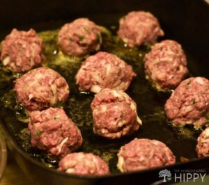 neat rows of meatballs in the electric frypan
