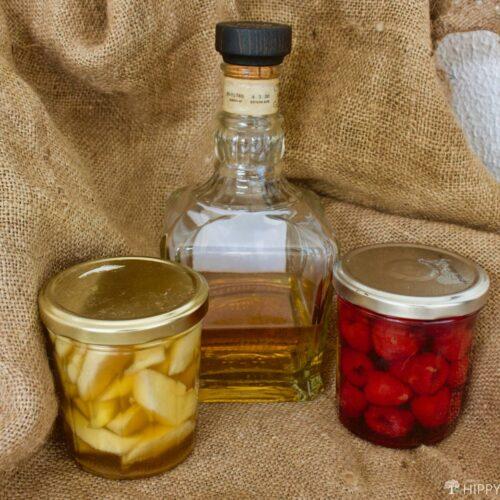 jars of brandied peaches and raspberries