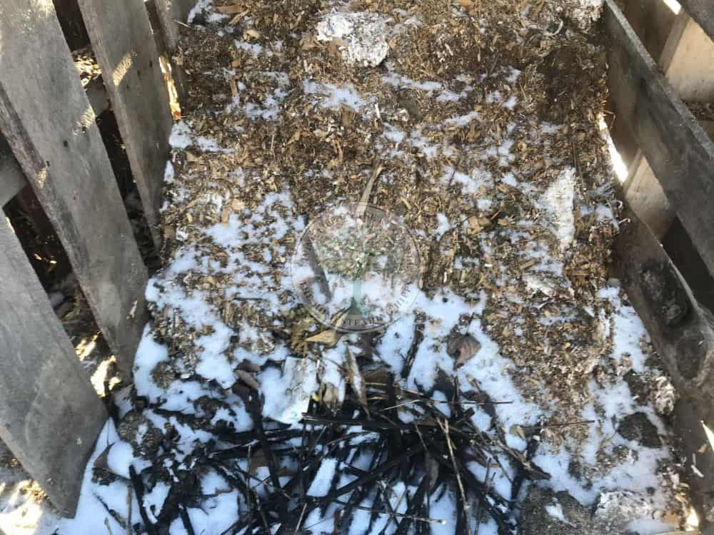 layered compost covered in snow