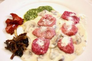 Beetroot gnocchi with truffle infused sauce