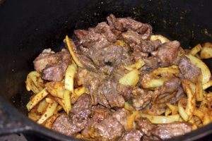 Lamb pieces browned and added to the braised onion