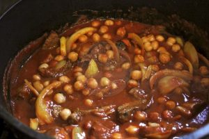 chickpeas, tomato added and ready to cook slowly