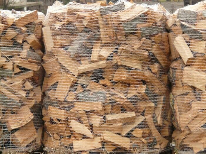 firewood stacked with a mesh
