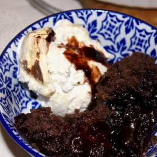 chocolate pudding in its own sauce with ice-cream