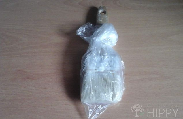 paintbrush in plastic bag
