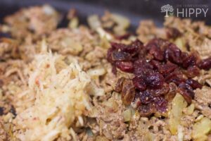 Grated apple (left) and raisins (right) added to meat