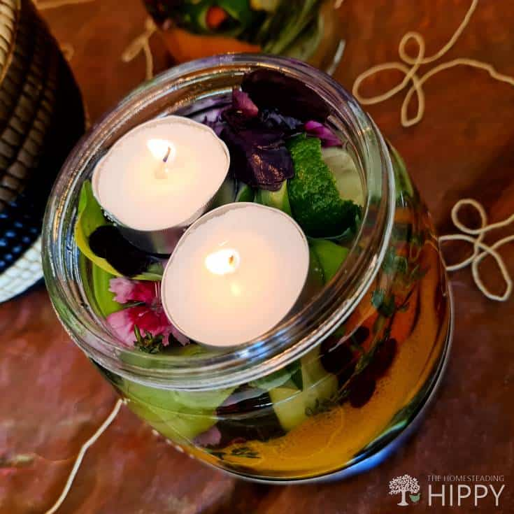 adding floating candles to citrus peel jar