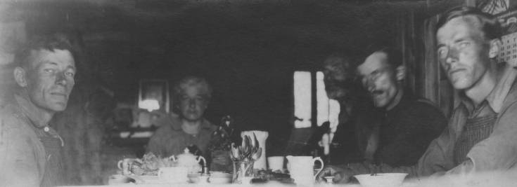 early pioneers over a table