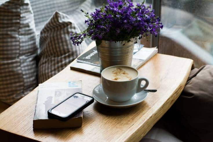 lavender flowers in vase on coffee table