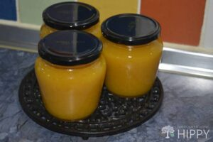 three jars of plum jam