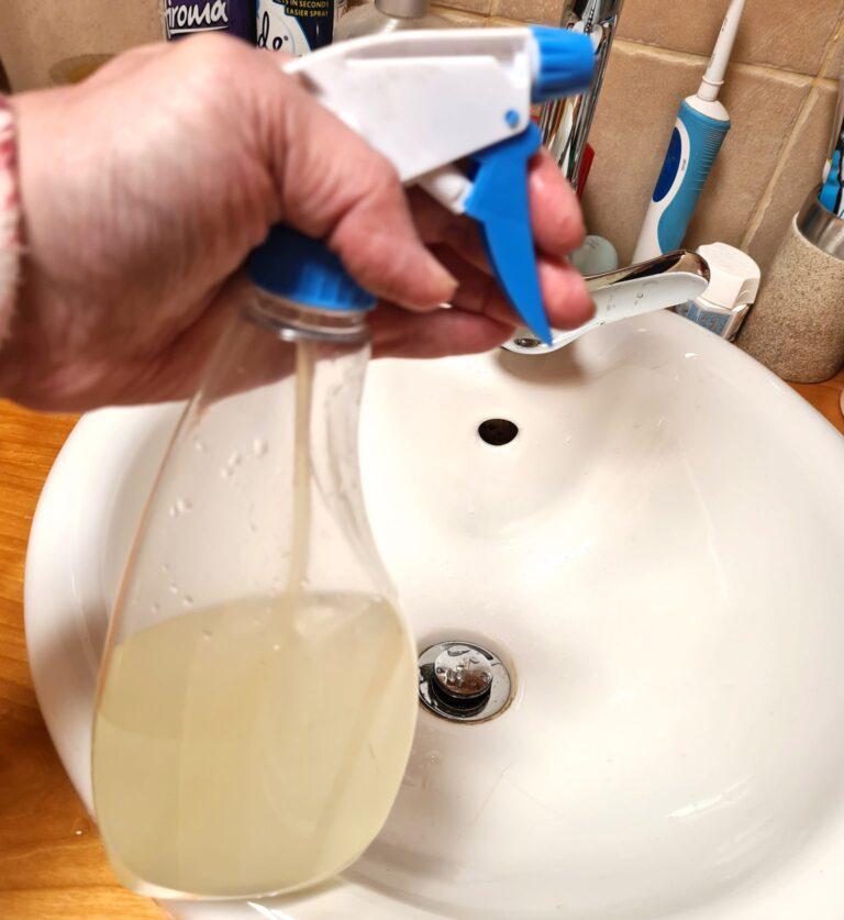 spray bottle with lemon juice and vinegar bathroom cleaner